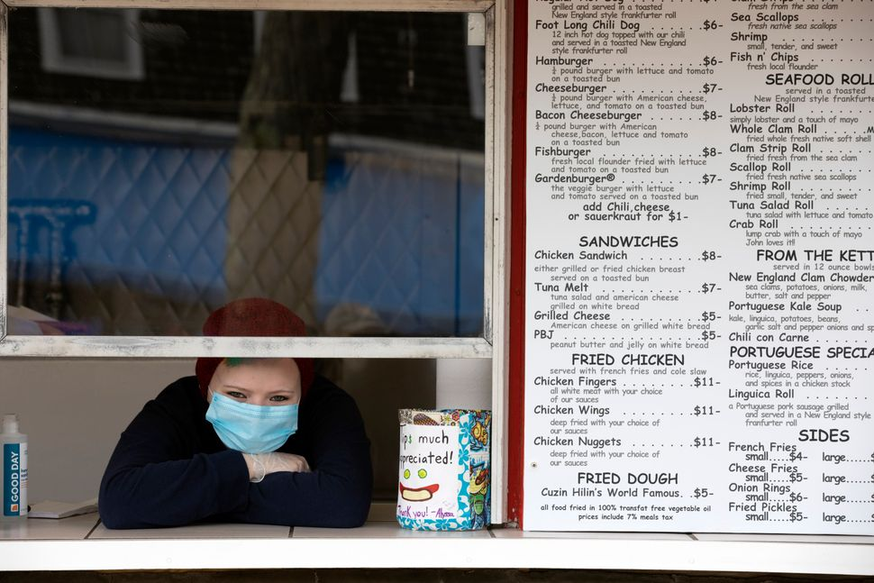Alyssa Costa waits for customers at a takeout window on May 25 in Provincetown.
