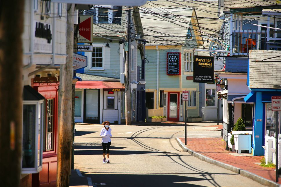 A jogger runs along an empty Commercial Street on May 13.