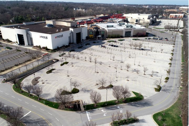 The parking lot surrounding Saint Louis Galleria mall is virtually empty Thursday, March 26, 2020, in Richmond Heights, Mo. (