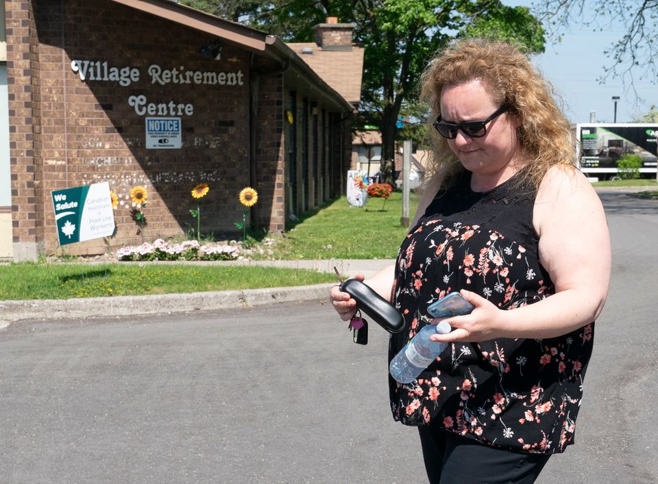 Cathy Parkes leaves Orchard Villa long-term care home in Pickering, Ont. on May 26,