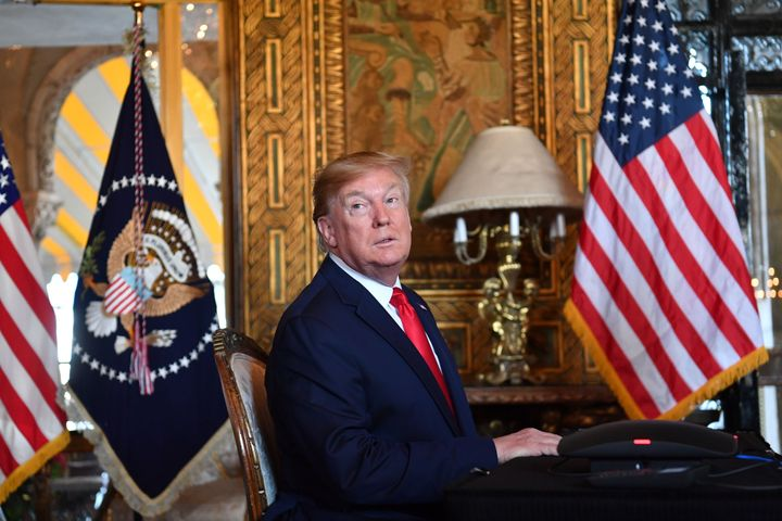 President Donald Trump answers questions from reporters after making a video call at his Mar-a-Lago estate in Palm Beach, Flo