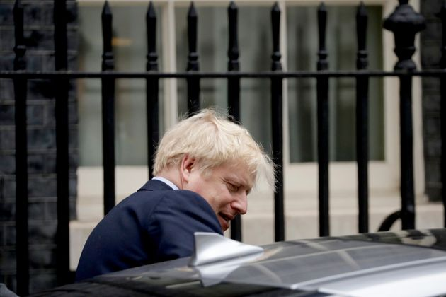 British Prime Minister Boris Johnson gets in a car as he leaves 10 Downing Street in London.