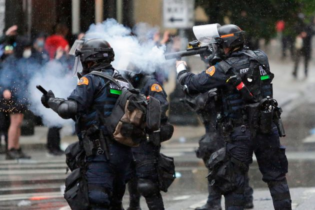 Washington State Police uses tear gas to disperse a crowd during a demonstration protesting the death...