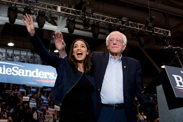 Former Democratic presidential candidate Sen. Bernie Sanders (I-Vt.) and Rep. Alexandria Ocasio-Cortez (D-N.Y.), left, take t