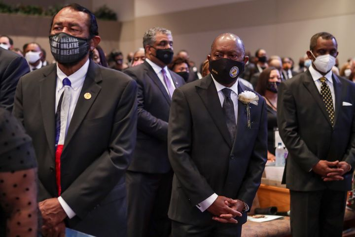 Congressman Al Green (L)D-TX and Houston mayor Sylvester Turner watch the family enter the sanctuary during  the funeral for