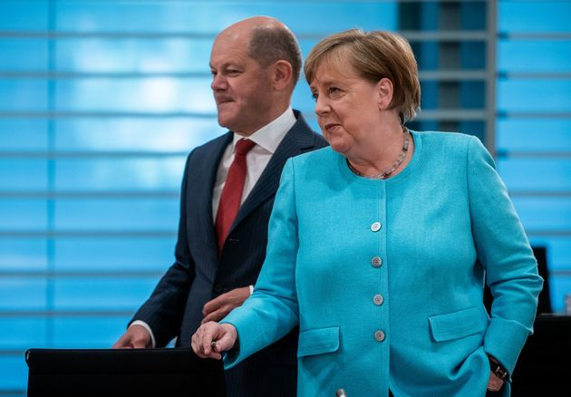 German Chancellor Angela Merkel and German Finance Minister and Vice-Chancellor Olaf Scholz arrive for...