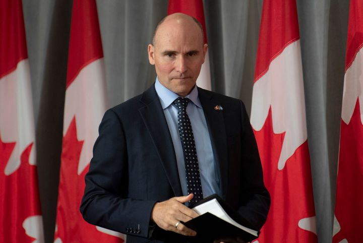 President of the Treasury Board Jean-Yves Duclos takes his seat before a news conference in Ottawa on June 9, 2020.