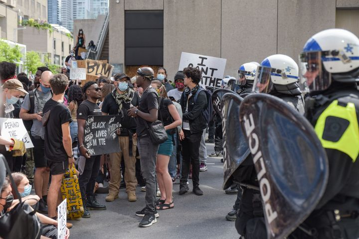 Montreal Police and protesters face off during a march against police brutality and racism in Montreal on on June 7 2020.