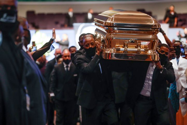 Pallbearers carry George Floyd's casket out after services Tuesday at The Fountain of Praise church in Houston.