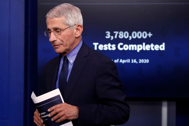 Dr. Anthony Fauci, director of the National Institute of Allergy and Infectious Diseases, walks from...
