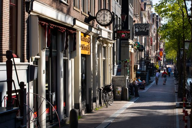 Amsterdam's red-light district is nearly deserted on April 24 after the Dutch government imposed regulations...