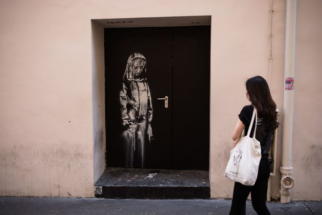 PARIS, FRANCE - JUNE 26: A recent artwork by street artist Banksy on a side street to the Bataclan concert...