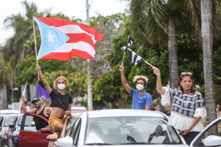 Demonstrators protest in front of the heavily guarded Capitol building in San Juan.