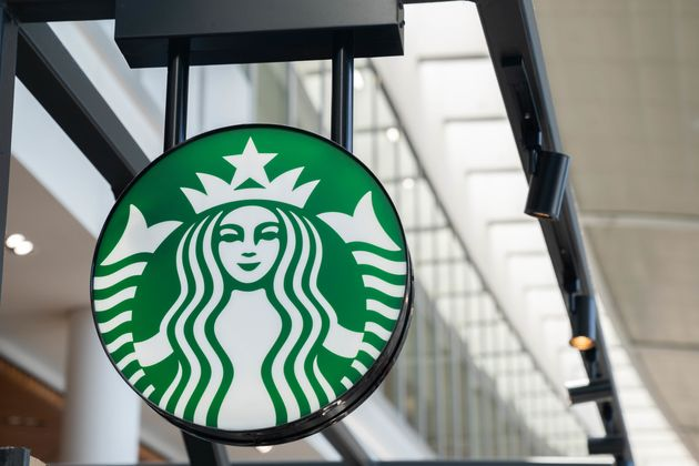 A Starbucks sign hangs above a location at Toronto Pearson International Airport in 2019 in Mississauga,...