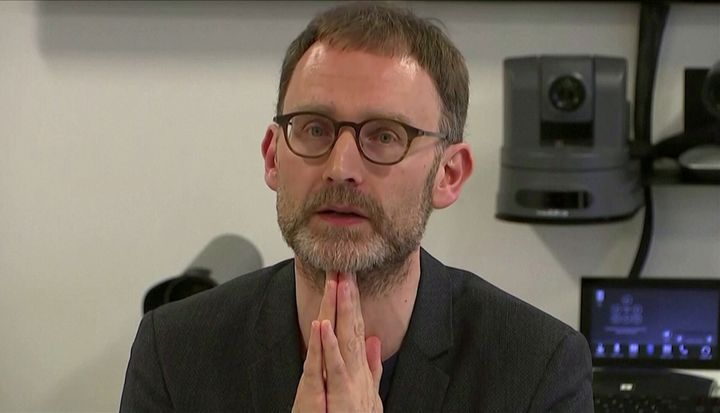 Epidemiologist Neil Ferguson speaks at a news conference in London, Britain January 22, 2020, in this still image taken from