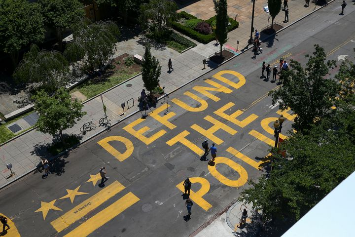 """""""Defund The Police"""" was painted on 16th Street near the White House in Washington on Monday."""