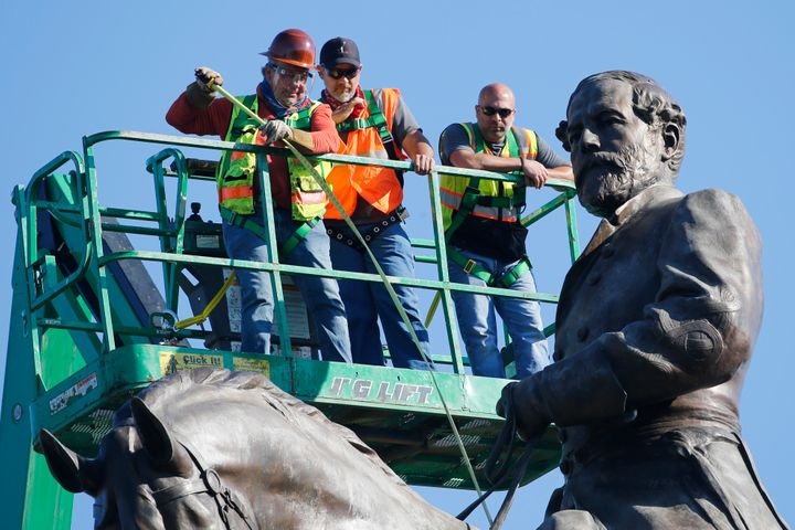 An inspection crew from the Virginia Department of General Services takes measurements as they inspect the statue of Confeder