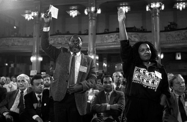 On their feet, MPs Bernie Grant and Diane Abbott, watched by MP Paul Boateng (far left), at the Labour...
