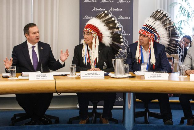 Alberta Premier Jason Kenney, left, sits with Grand Chief Wilton Littlechild, centre, Grand Chief Arthur...