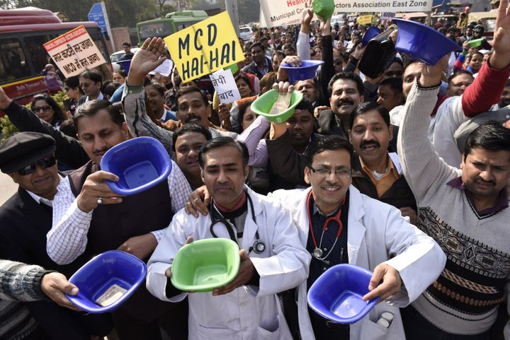 Not much has changed. In this photo, municipal corporation employees including doctors, medical staff, teachers can be seen begging with bowls during a protest march against nonpayment of their salaries on February 2, 2016 in New Delhi.