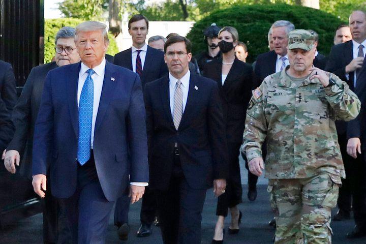 Walking behind President Donald Trump from left are, Attorney General William Barr, Secretary of Defense Mark Esper and Gen.