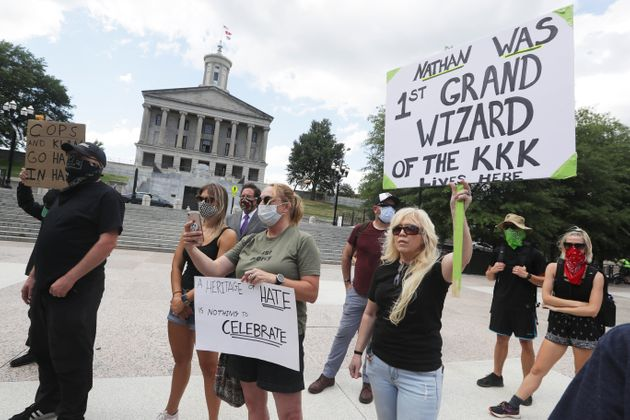 Demonstrators take part in a protest Wednesday outside of the Tennessee Capitol. The bust of Nathan Bedford...