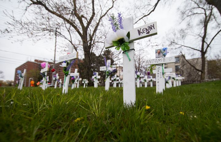 Crosses with flowers for residents who have lost their lives due to COVID-19 outside the Camilla Care Community in Mississauga, Ont. on May 12, 2020.