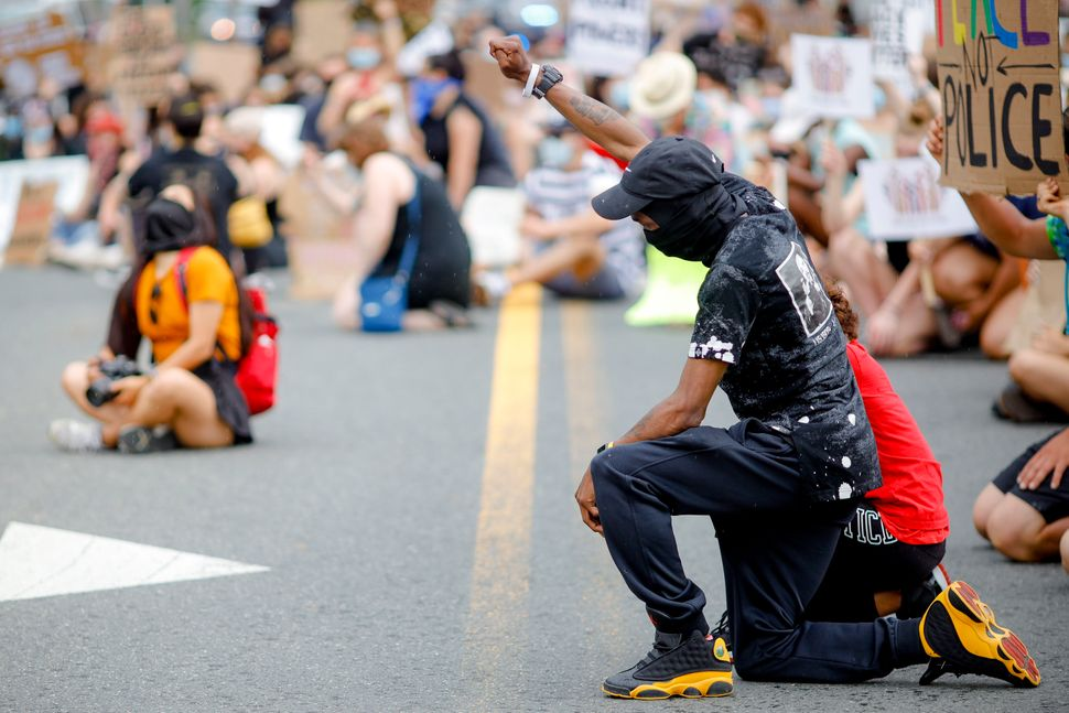 Jemel Black and his 11-year-old daughter, Tyarah, kneel June 6 with other protesters in Great Barrington, Massachusetts,