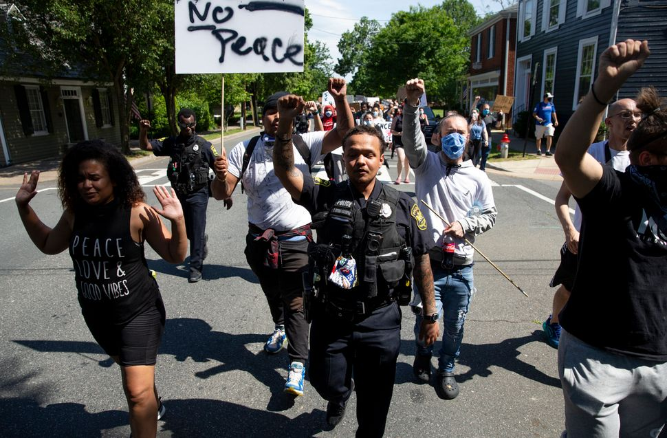 In Fredericksburg, Virginia, police officers, including Uyurre Brown-Kaleopaa, center, join protesters in a June 2 march. Bla