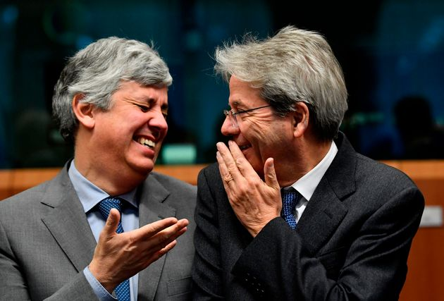 Eurogroup President and Portugal's Finance Minister Mario Centeno (L) smiles as he talk with EU commissioner...