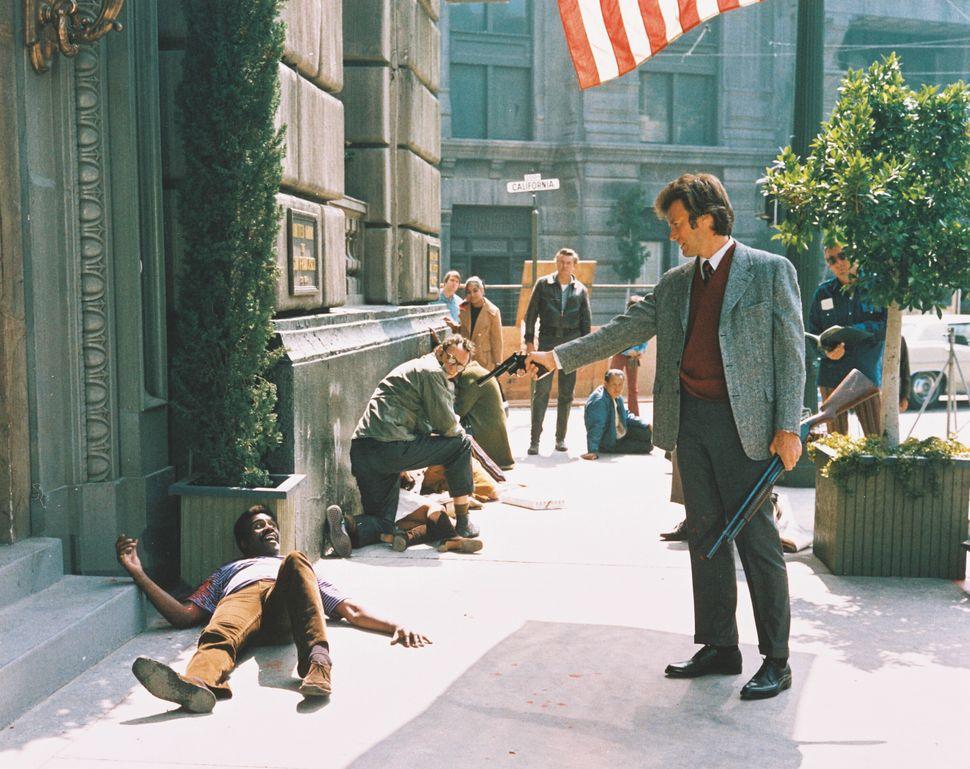 """Clint Eastwood taking aim at Albert Popwell in """"Dirty Harry."""""""
