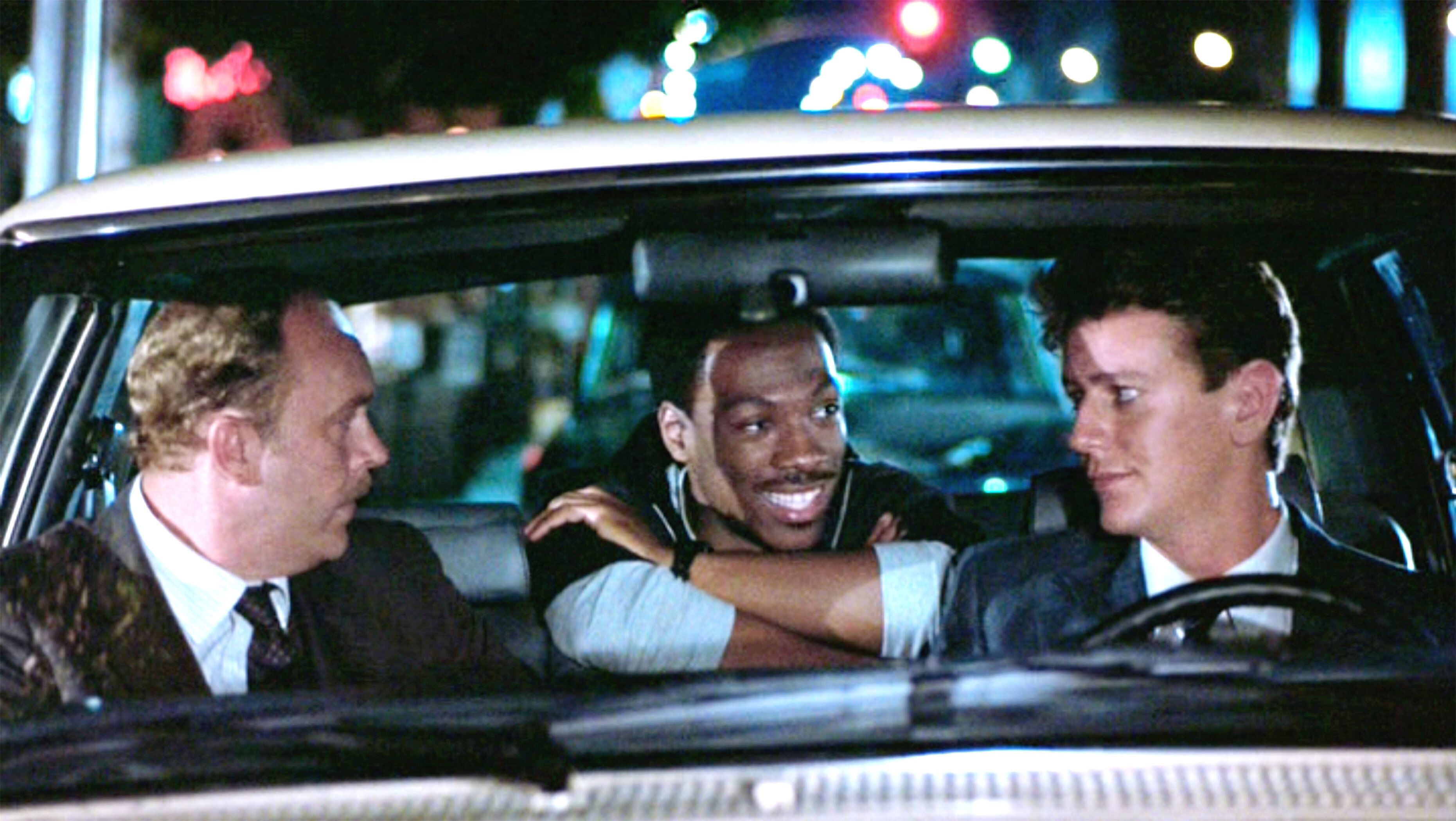 "John Ashton, Eddie Murphy and Judge Reinhold in ""Beverly Hills Cop."""
