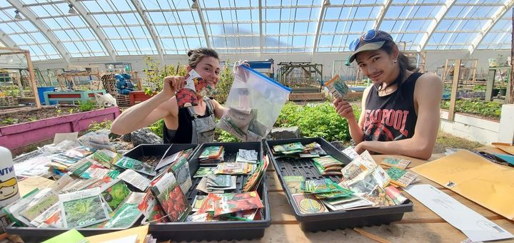 Inuvik Community Greenhouse staff pose with seeds donated by southern Canadians.