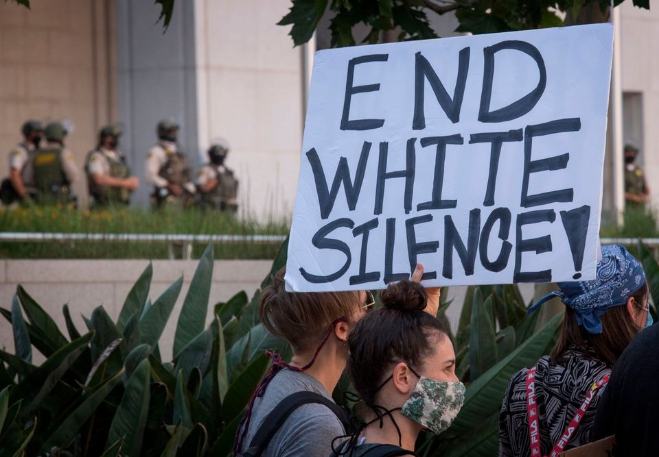 Supporters of Black Lives Matter, hold signs during a protest outside the Hall of Justice as they demonstrate...