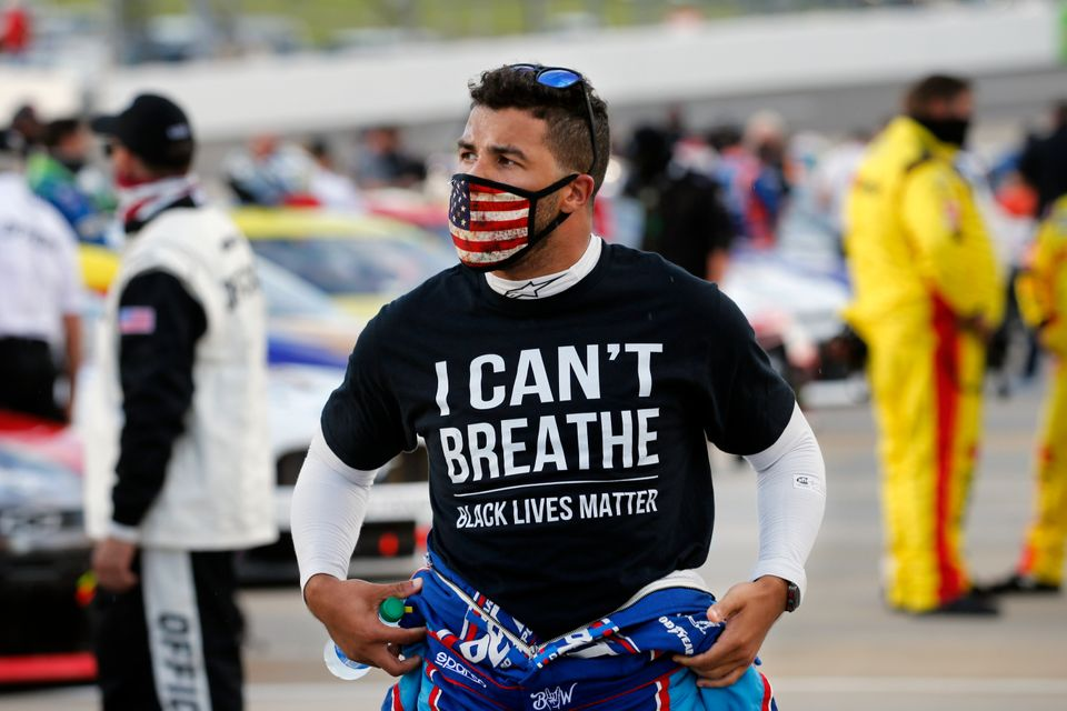 Driver Bubba Wallace wears a Black Lives Matter shirt as he prepares for a NASCAR Cup Series auto race...