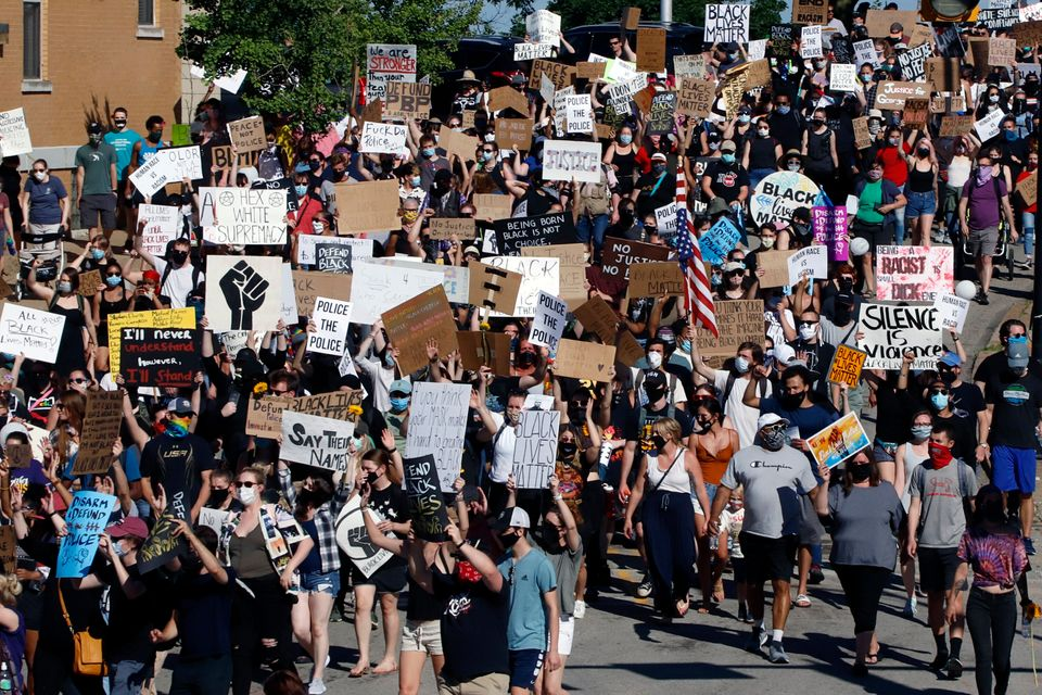Protesters participating in a Black Lives Matter rally march to Downtown Pittsburgh from Mount Washington...