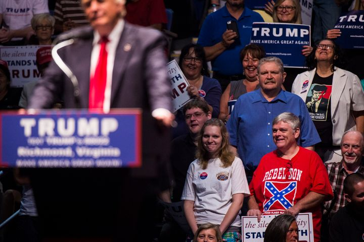 A supporter wears a Confederate flag shirt as Donald Trump speaks at a campaign rally on June 10, 2016, in Richmond, Virginia