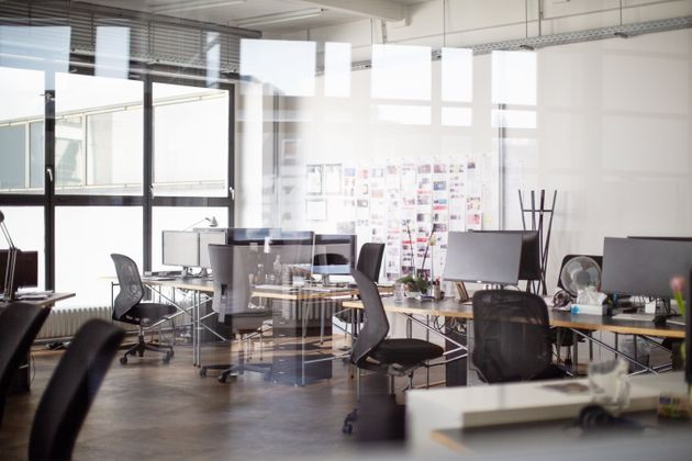 Interior of open office with desk and chairs. Modern office space
