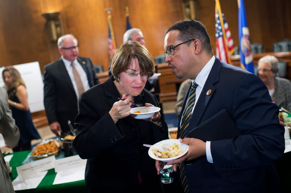 Ellison consults with Sen. Amy Klobuchar (D-Minn.) in Congress in 2016. Despite their ideological differences, they have a lo