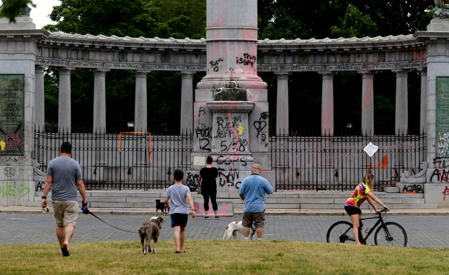 People gathered at the Jefferson Davis monument in Richmond, VA. on Thursday morning after the statue...