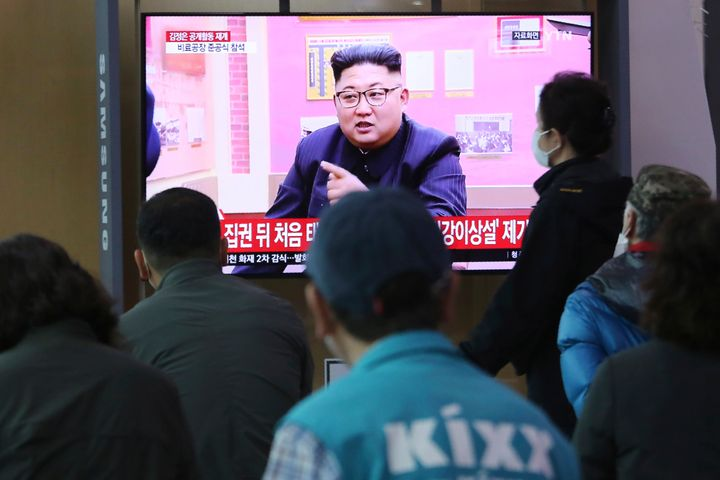 People watch a TV showing a file image of North Korean leader Kim Jong Un during a news program at the Seoul Railway Station