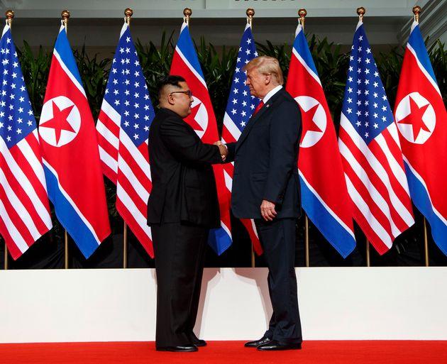 In this June 12, 2018, file photo, North Korean leader Kim Jong Un, left, and U.S. President Donald Trump...