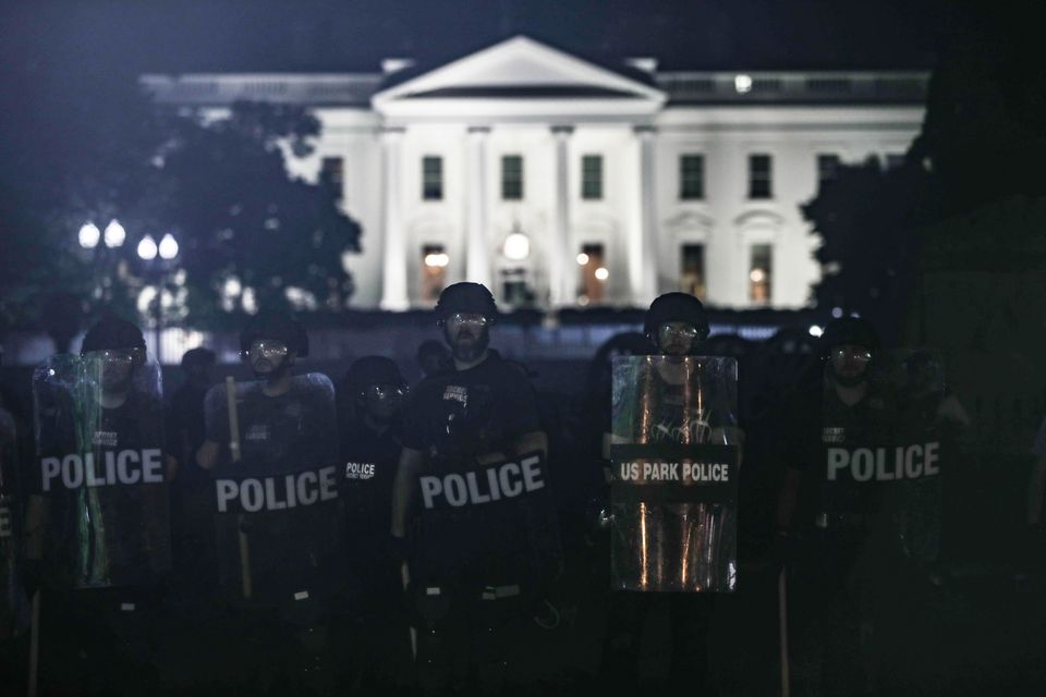 Police take security measures near White House during a protest over the death of George