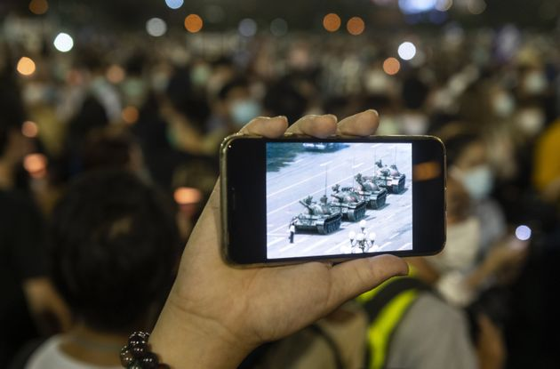 HONG KONG, CHINA - JUNE 04: A man displays an image on his smartphone of the Tiananmen crackdown during...