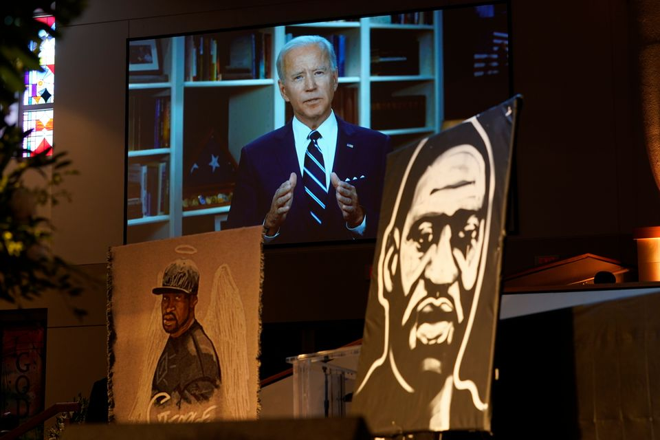 Joe Biden speaks via video link as family and guests attend the funeral service for George