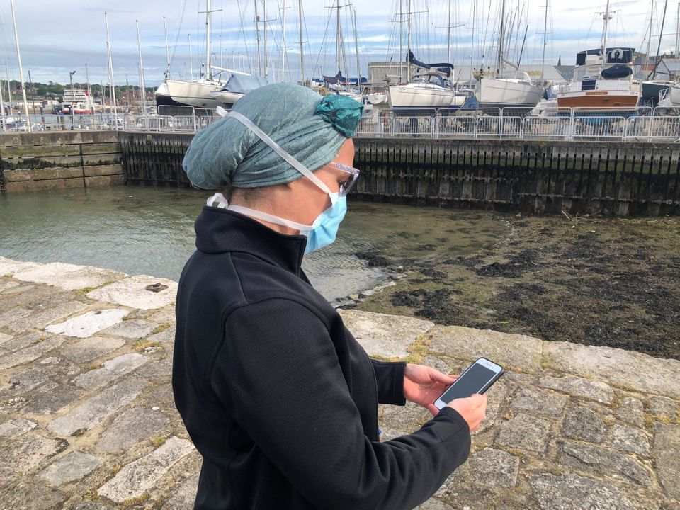 An NHS employee using the app to trace contacts with people potentially infected with the coronavirus...