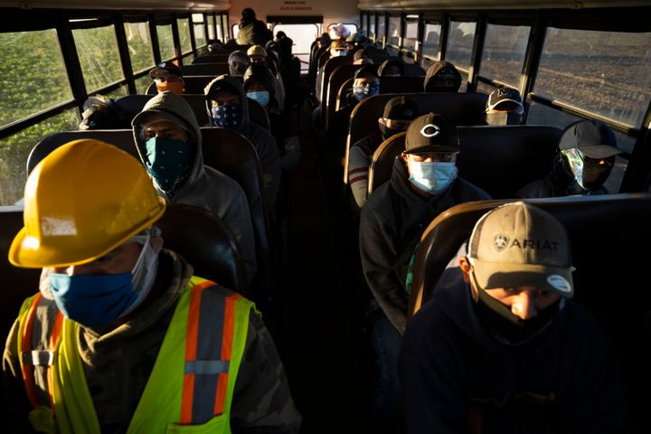 Farm laborers from Fresh Harvest arrive for their shift on April 28, 2020 in Greenfield, California.