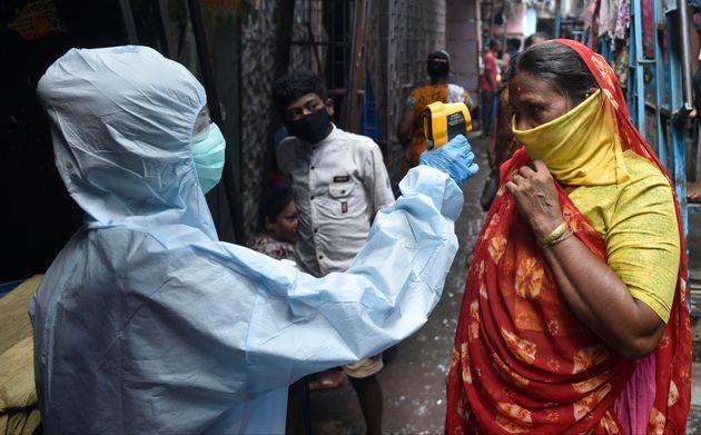 Health workers conducting coronavirus testing drive in Dharavi on June 11, 2020 in