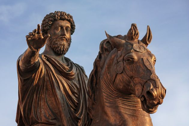 This sculpture, a bronze replica of an ancient statue of the Roman emperor, is located in the center...
