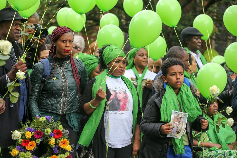 Survivors, family and friends of the victims wearing symbolic green scarves and holding green balloons...